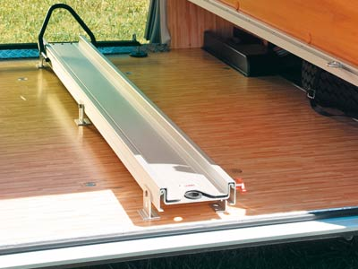Rail for secure housing of motorbikes in motorhome garage
