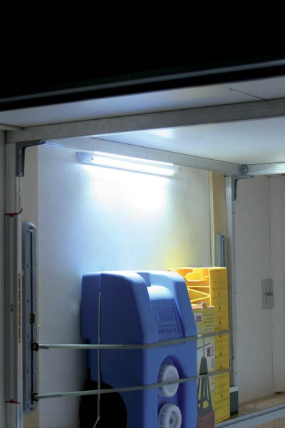 Install light in motorhome or caravan storage compartment or cupboard