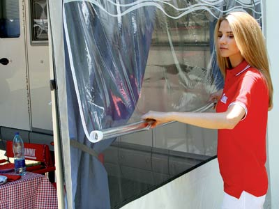 Roll up clear vinyl windows reveal mosquito netting