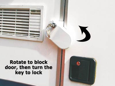 Rotates to block the caravan door from opening